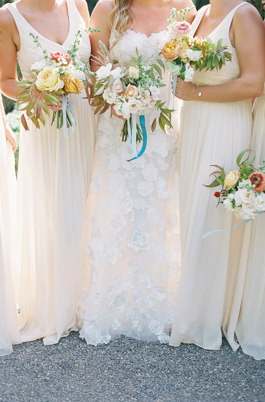 detail of bridesmaids dresses and bouquets at a napa wedding at the venue beaulieu gardens