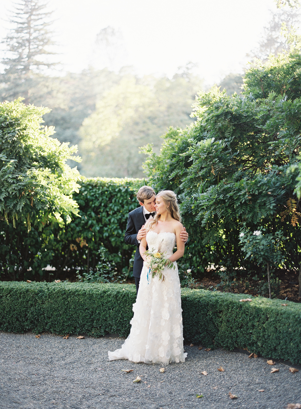 bride and groom portrait shot on fuji 400h at beaulieu gardens in Napa wine country