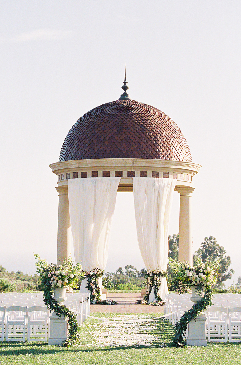 a colorful garden themed wedding ceremony at pelican hill resort in california
