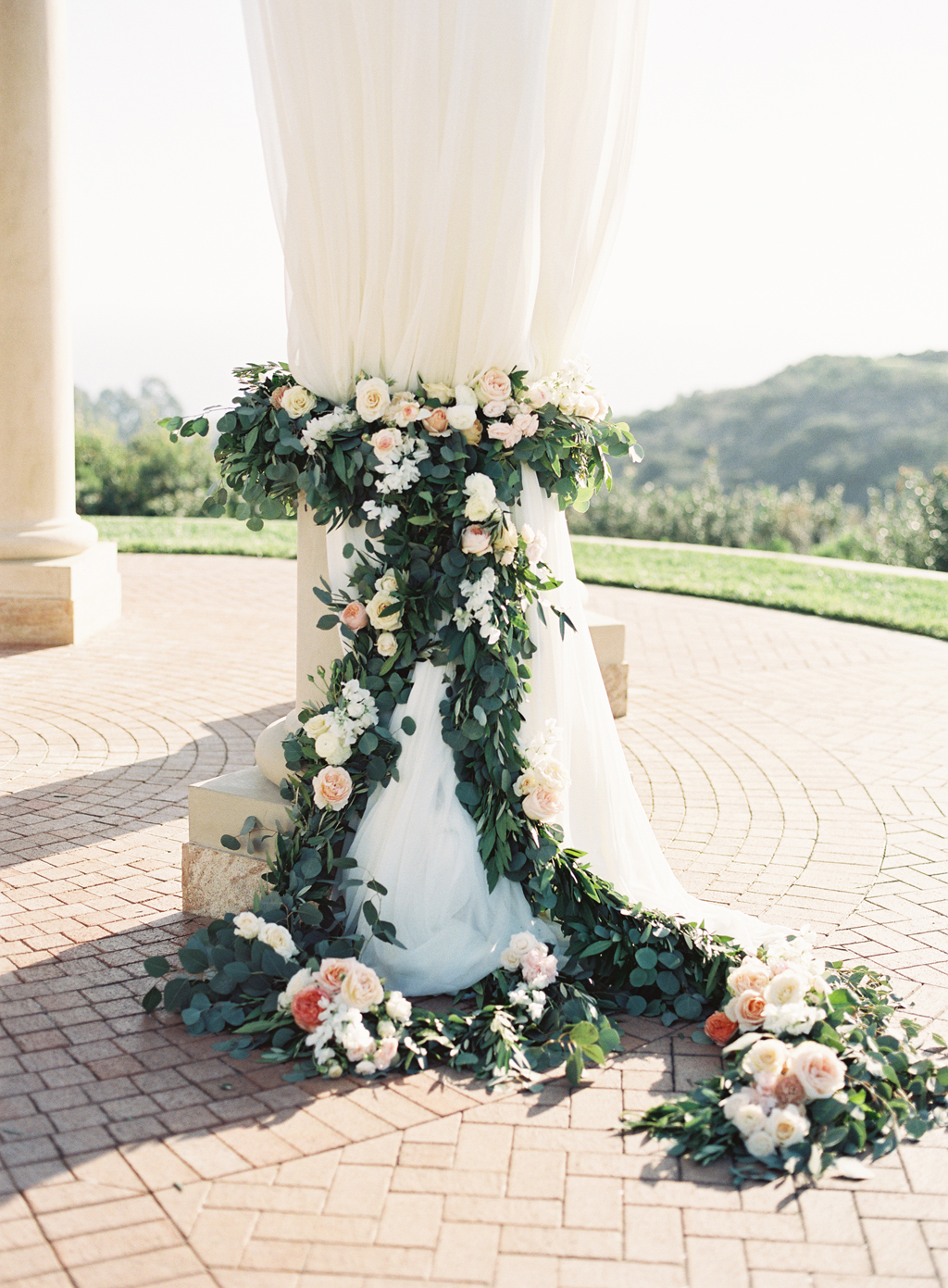 a film photograph of ceremony florals by art with nature.