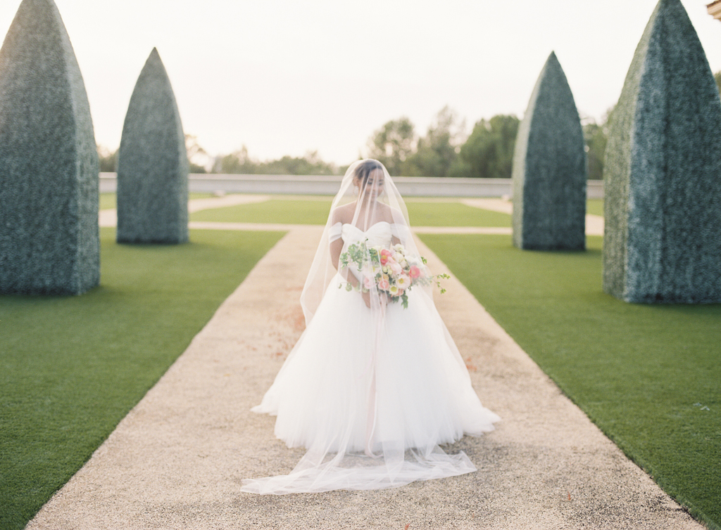 film photograph of a bride on her wedding day at pelican hill resort in California that looks Tuscan.