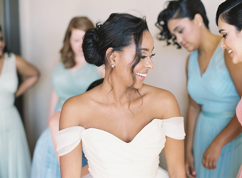 a bride and her bridesmaids getting ready in their suite at pelican hill