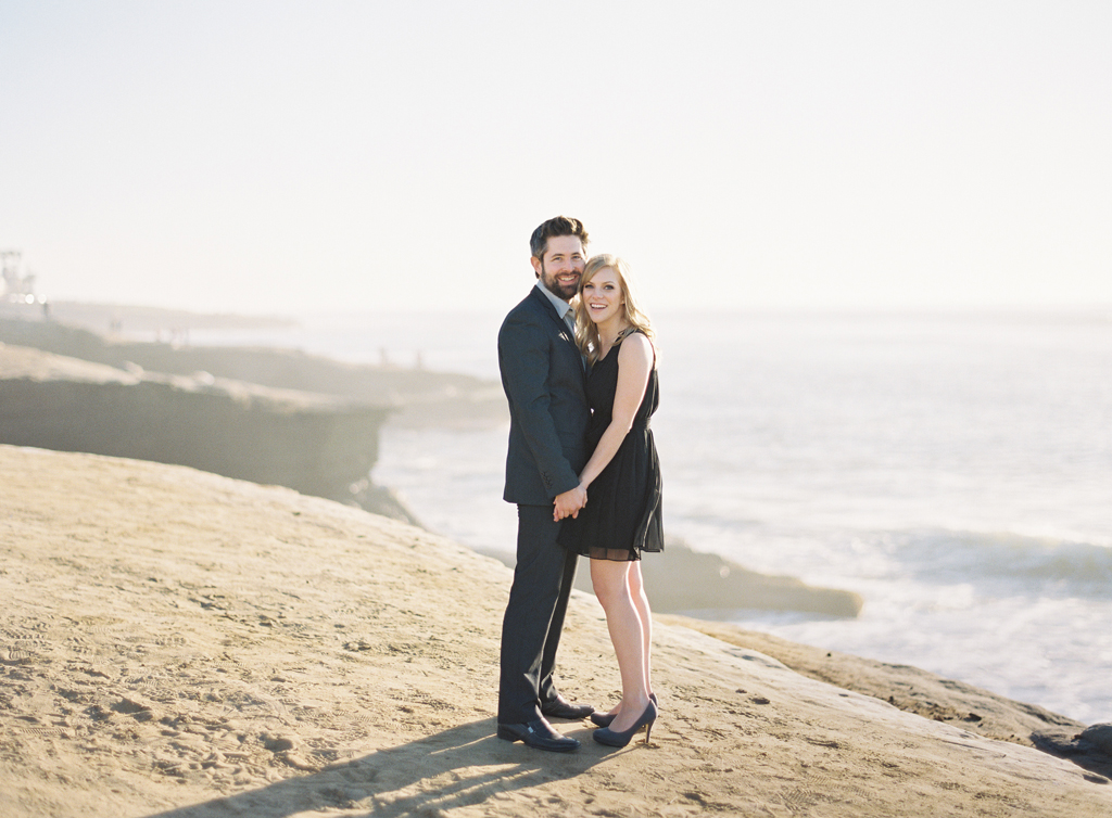 standing along a cliff in southern california, this couple poses for their engagement session captured on film photography.