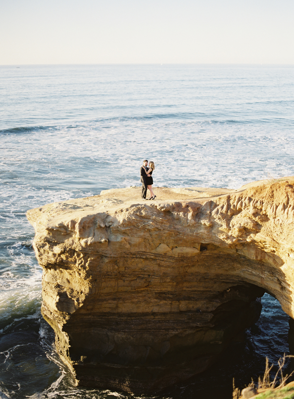 a southern california engagement session captured on film along the coast.
