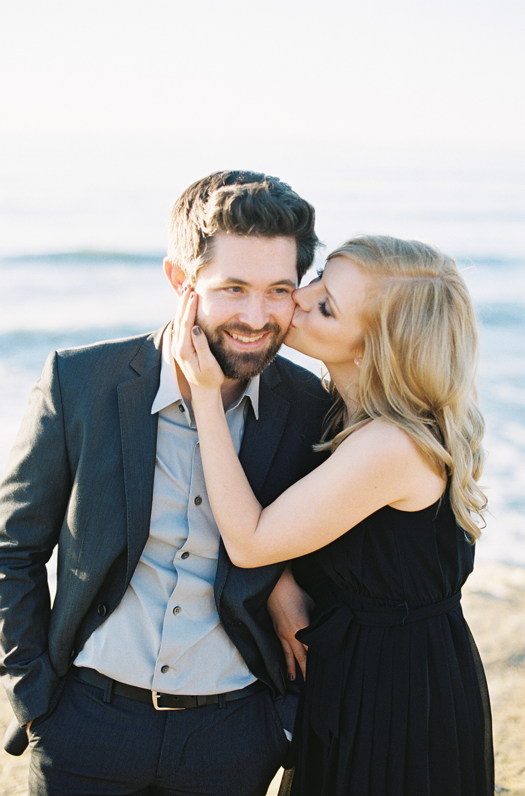 a soon-to-be bride kissed her fiance during their coastal engagement session in San Diego.