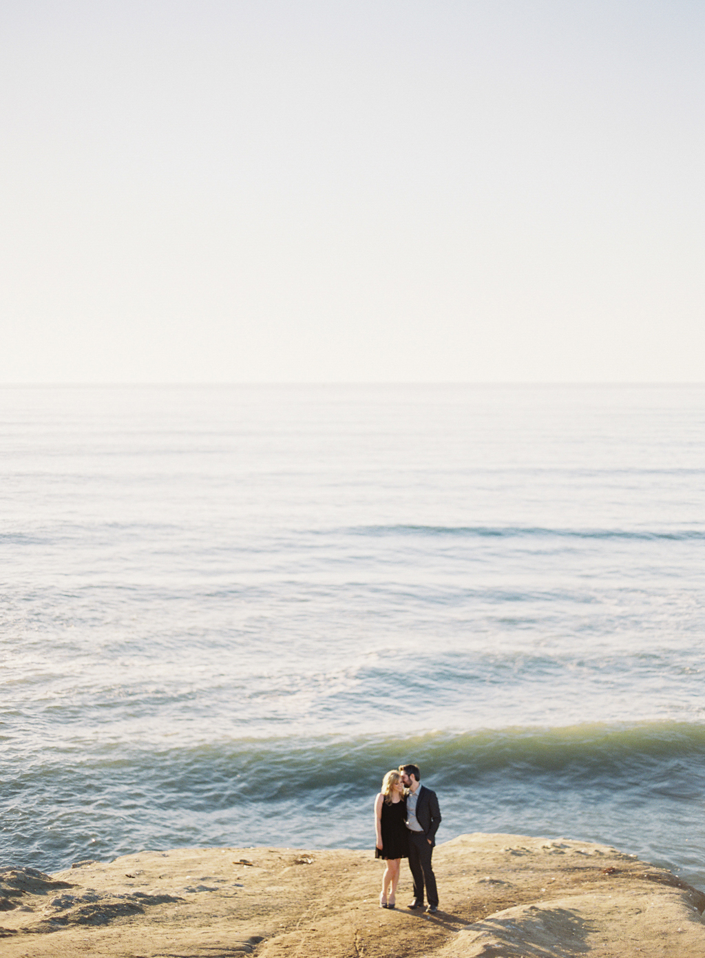 a light filled coastal engagement in southern california captured on film photography.