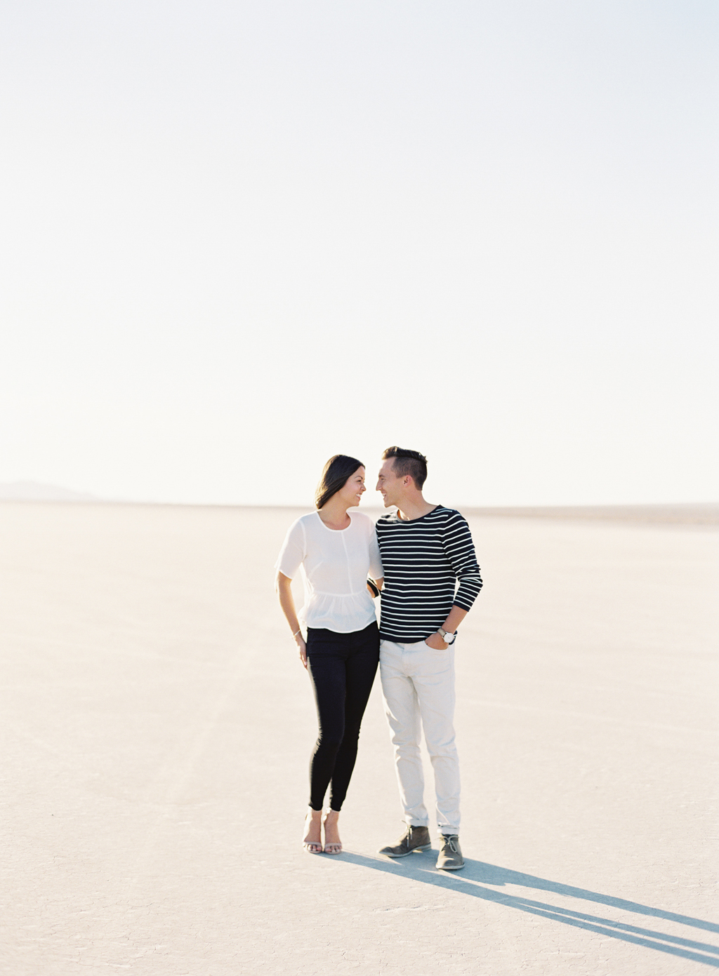 brandon kidd and kristin kidd pose in the California Desert for portraits.