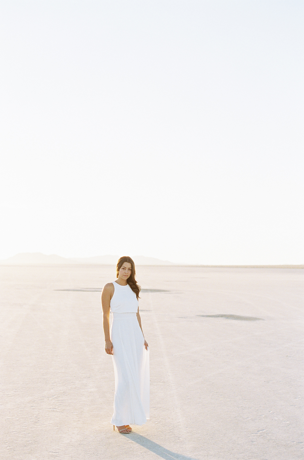 photographer, kristin kidd, poses for a film photograph in the california desert, shot on fuji 400h.