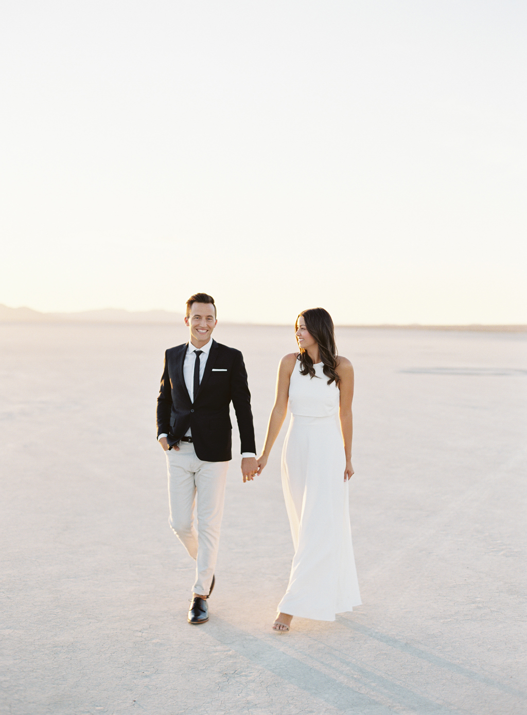 brandon and kristin kidd walk through the california desert.
