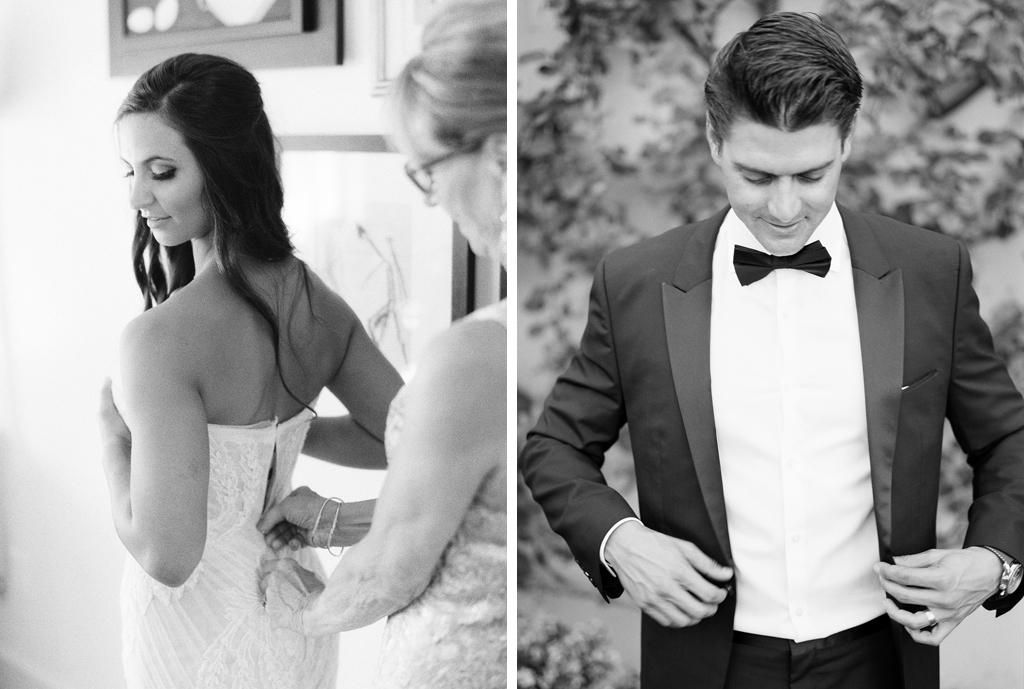 a black and white photo of a bride getting her dress on and a groom buttoning his suit on their wedding day in Napa valley California wine country.
