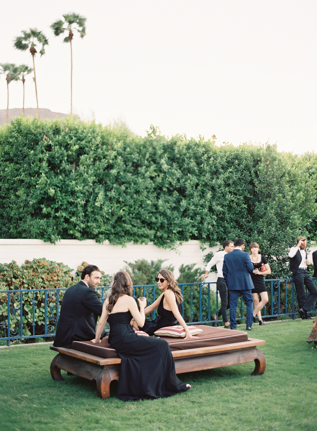 guests lounging during cocktail hour at a wedding in Palm Springs.