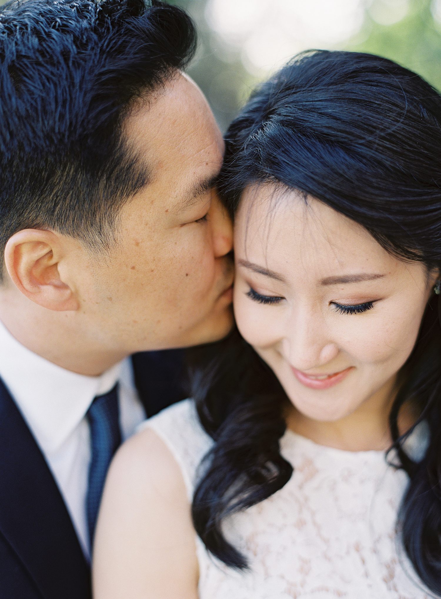 a close up photograph of a couple during their engagement session at greystone mansion in southern california.